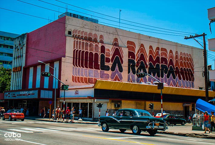 La Rampa cinema in Vedado, an old car passing by © Cuba Absolutely, 2014 - 2020